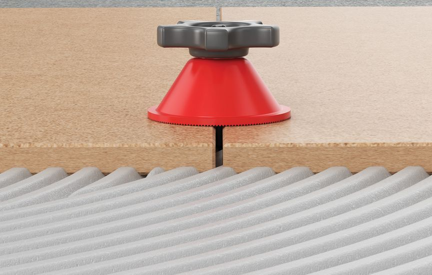 затяните гайку с требуемым для фиксации нивелированной плитки усилием